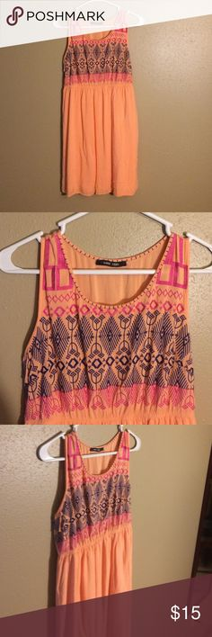 Coral/peach dress Coral/peach mini dress. Aztec print on top, flowy bottom. Waist is elastic. west 36th Dresses Mini