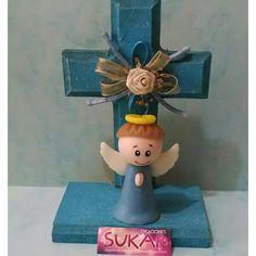 Angelito en cruz