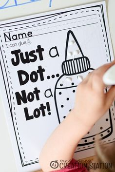 "Teaching children to use glue bottles correctly. ""Just a dot, not a lot!"""