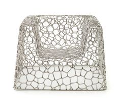 Marc Newson. Love this chair. Love the shapes created and I think being a low and deep chair it could be comfortable!