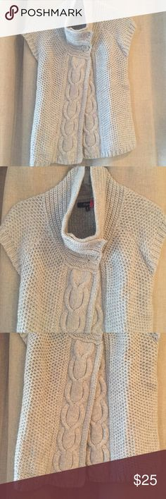 🆕 Listing! Express Grey S/S Flyaway Cardigan Express grey short sleeve flyaway cardigan with double button closure at neck. Approximately 23 inches total length. Material 52% cotton, 35% nylon, 6% wool, 5% angora rabbit hair. Dry clean. Express Sweaters Cardigans