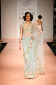 A very delicate yet elegant saree with a pretty flower border - Lakme Fashion Week India Ethnic Fashion, Indian Fashion, Indian Dresses, Indian Outfits, Beautiful Saree, Beautiful Dresses, Saree Trends, India Fashion Week, Elegant Saree