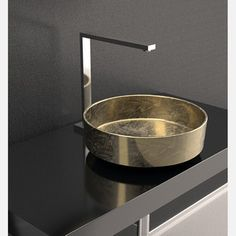 Rho Lux Sink Gold Leaf now featured on Fab. Distinctive sink and faucet design.