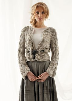 Longer at the bottom and sleeves at 3/4.  Side to Side Cable Cardi