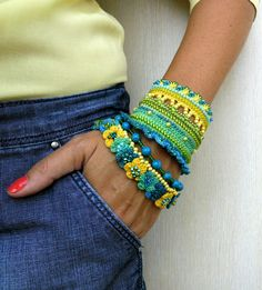 Hey, I found this really awesome Etsy listing at https://www.etsy.com/listing/455140894/crochet-bracelet-cuff-green-yellow