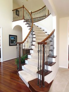Traditional Staircase with High ceiling, Metal staircase, Hardwood floors, Bellawood x Select Brazilian Cherry White Living Room Set, Brazilian Cherry Hardwood Flooring, Grand Stairway, Staircase Runner, Traditional Staircase, Minnesota Home, House Stairs, Floor Decor, Staircase Design