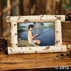 Foto lijst gemaakt met berken stam www.decoratietakken.nl