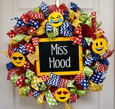 This wreath can complement your classroom emoji theme. It measures approximately 22-24. It is made with a red mesh. The center features a chalkboard sign that can be customized with whatever message you would like. It also has wooden emojis, and ribbon for decorations. This wreath is intended for indoor use only. Put in the conversation notes, what you would like on the chalkboard. I will use permanent vinyl for the name or saying. San Antonio residents can save on shipping by picking up in…