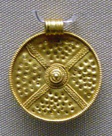 Gold disc pendant with filigree saltire and central boss from Sutton Hoo.