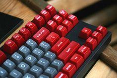Muirium's Novatouch with red/gray 7bit R5 caps.