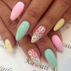 Lovely spring coloured nails with flower details.
