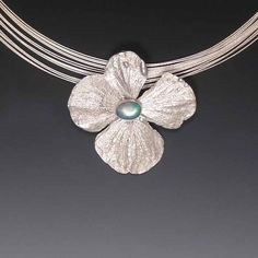 Hydrangea bloom cast into sterling and set with Australian opal - pendant from Carina Rossner Organics