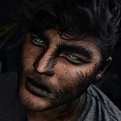 """Werewolf makeup tutorial is now live! Want to know how I did it? Click the link in my bio Products used: @anastasiabeverlyhills Creme Contour Kit in """"deep"""", and their NEW """"Self-Made"""" eyeshadow palette for the eyes, @mehronmakeup """"Paradise Paint"""" in black, the @tartecosmetics double liner brush for all the hair strokes BOMB, @nyxcosmetics Primal Color Face shadow in black, and contacts are by @camoeyes.com_"""