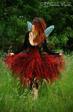 Knee length net tutu by TPF Faerie Wear.  All T.P.F. Faerie Wear Tutus are made on a 2m ribbon that ties round the waist rather than being