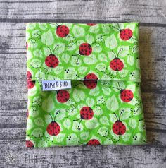 This gorgeous pad wrapper features cute ladybirds  Designed to keep your clean pad in while you are away from home, and then you can replace it with a soiled pad when you need to change, as it has a waterproof lining. Small and discreet.  FEATURES:  Size: 13cm x 13cm Fabrics ~ woven cotton & PUL lining  Flip top design  You will receive the pad wrapper pictured above  ** The pad is shown as an example of use only. It is not included in this listing **  CARE INSTRUCTIONS Hand or machine wa...