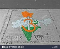 Stock Photo - Rangoli made of Indian flag with Holy Icons, Om, Holy Cross, Star and moon, India
