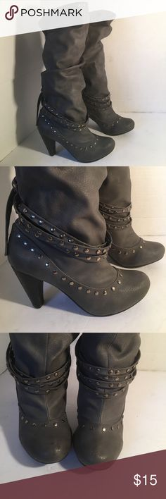 "Like New Gorgeous Gray Studded Boots Beautiful Gray boots with scrunch effect and studded embellishments. Ankle strap accents and tassels in back. Rounded toes and small scuff mark on inside right boot. They are in excellent condition. Soles excellent condition! 2.5"" heels. YOU CAN BUY 1 ITEM BUT CAN ONLY PURCHASE UP TO 3 ITEMS PER ORDER. OR YOUR ORDER WILL BE CANCELED. Non Rated Shoes Heeled Boots"