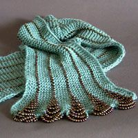Knitted scarf with beads. So cool - this is just like the necklace in 101 One Skein Wonders (the 2nd one) Neat idea!