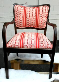 I would LOVE to learn how to upholster a chair someday...I think I just have a great need to turn junk into treasure. Love this re-upholstered chair from Design Sponge and the Aztec Pathway fabric.