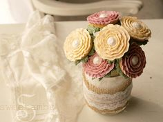 Arrange the flowers in a vase or jar filled with granulated or sparkling sugar. The sugar helps to hold the flowers in place and allows you to easily ...