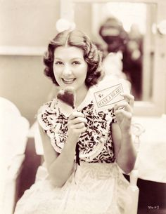 """The year is 1934. The original photo caption reads, """"HAVE A HEART ICE CREAM – This novel heart-shaped ice cream was manufactured especially for use in 'Have a Heart,' Jean Parker's first starring role for Metro-Goldwyn-Mayer, in which her romance is started with James Dunn when he offers her his novel brand of ice cream."""""""