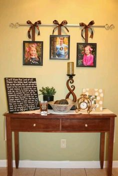 Use a curtain rod to hang pictures - cute idea