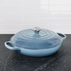 Free Shipping. Shop Le Creuset ® Signature 3. 5 qt. Marine Blue Everyday Pan. This cast iron pan is clad in smooth, vitrified porcelain in sea-inspired blue, making it impervious to acid, alkali, odors and stains.