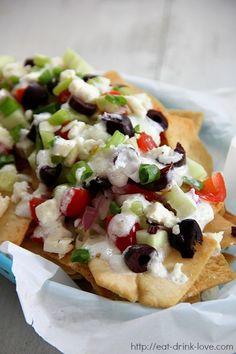 Greek Nachos ~ Crispy pita chips topped with fresh cucumber, onions, tomatoes, kalamata olives, feta cheese, and tzatzkiki