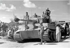 A Tiger 1 and crew in Tunis, Tunisia during early 1943 getting a lot of attention from locals and soldiers alike.