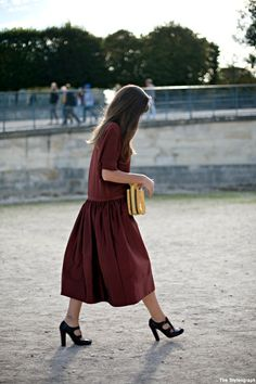 burgundy outfit with a midi skirt