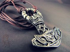 Pewter Mjolnir Pendant by JupitersHaven on etsy.com. I love how the design looks like a cat or a fox. :3