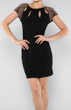 Black Cocktail Dress 68.00 Black Cocktail with Gold Shoulder Embellishment.  Rayon/Polyester/Spandex