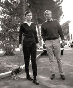 """Audrey Hepburn in the gardens at Cinecittà film studios in 1958, with actor Peter Finch, her co-star in """"The Nun's Story"""""""