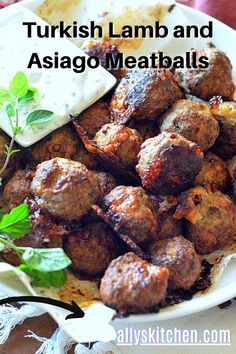 Asiago lamb meatballs will be perfect as an appetizer or for dinner! So simple to make, you'll bite into glorious global flavors and creamy asiago cheese! #meatballrecipe #lambrecipe