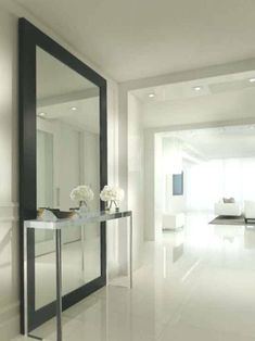 , Contemporary Hallway Design Ideas With Stainless Console Table Also Huge Modern Mirror With Black Frame Also White Tile Floor Also White Wall Paint Color Also Small Ceiling Lights Also White Modern Furniture: Hallway designs to Make Your House Better Halle, Contemporary Floor Mirrors, Hallway Designs, Hallway Ideas, Hallway Inspiration, White Wall Paint, Hallway Mirror, Foyer Flooring, Hallway Colours