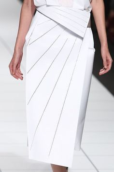 White skirt with crisp folds & perforated lines; architectural fashion details // Issey Miyake #NaaiAntwerp