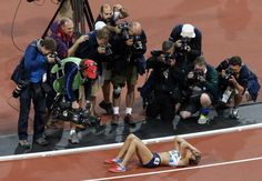 Members of the media crowd around Great Britain's Jessica Ennis right after she won the heptathalon.