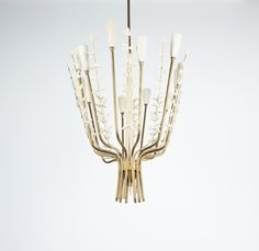 Rupert Nikoll Aida brass chandelier, Austria, circa 1950. 12 bulbs with 40W each (e14). It's in good original condition, gently refurbished.