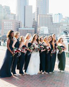 A Contemporary Wedding at a Boston Art Museum | Martha Stewart Weddings - Clad in navy-chiffon Amsale gowns from L'Elite Bridal, the bridesmaids joined Danielle for some pre-ceremony portraits by the water.