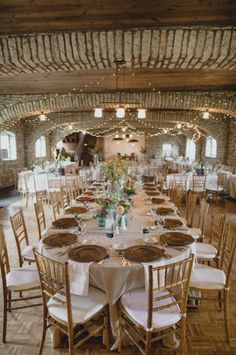 Winery wedding reception with family style seating and elegant decor. #weddingreception #weddingdecor #weddingchicks Wedding Design: Jill Drazkowski ---> http://www.weddingchicks.com/2014/05/02/3-reasons-why-wedding-buffets-rock/