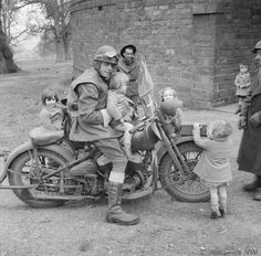 Canadian despatch rider attracts a group of fans.