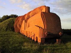 Brick Train is the public art installation of a life-size steam locomotive by Scottish sculptor David Mach. Replicating the 1938 Mallard, it is comprised of over 185,000 bricks and settled along the A66 on the edge of Darlington, Durham, England.