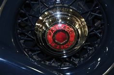 1935 Packard Model Twelve spoked wheel and hubcap.  Photography by David E. Nelson