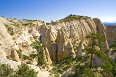 Kasha-Katuwe Tent Rocks National Monument (New Mexico) - The area owes its remarkable geology to layers of volcanic rock and ash deposited by pyroclastic flow from a volcanic explosion within the Jemez Volcanic Field that occurred 6 to 7 million years ago. Over time, weathering and erosion of these layers has created canyons and tent rocks. The tent rocks themselves are cones of soft pumice and tuff beneath harder caprocks.