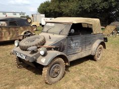 A restored Volkswagen Kubelwagen muddied up during a reinactment display.
