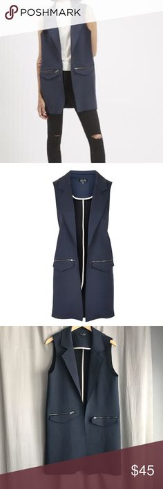 Topshop • Long Navy Vest Topshop long Sleeveless navy coat. Raw edges. Two front zip pockets. US Size 10 Topshop Jackets & Coats Vests