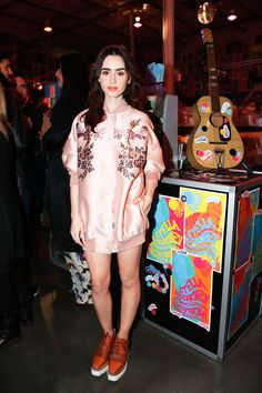 Lily Collins in an embroidered silk set and platforms at the Stella McCartney party