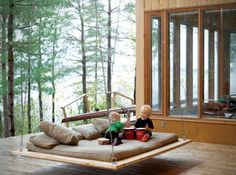 Simple barn wood hanging bed for outdoors