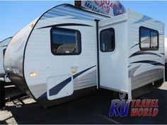 The EVO T1850 travel trailer by Forest River offers a U-shaped dinette slide out, a rear bath, and a RV bed up front.