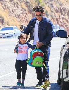 He's a slam dunk! Orlando Bloom was spotted escorting his adorable son Flynn through their...